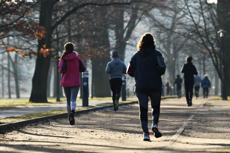 Joggers run at the Volkspark Friedrichshain in Berlin