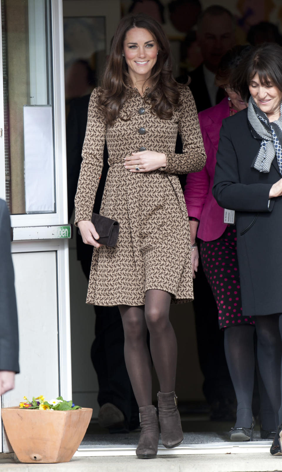 <p>For a trip to Oxford, Kate dressed in a printed Orla Kiely dress with Aquatalia ankle boots and a black clutch.</p><p><i>[Photo: PA]</i></p>