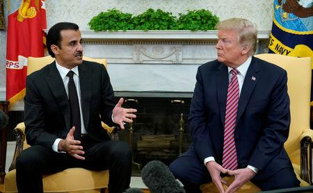 FILE PHOTO: U.S. President Donald Trump meets Qatar's Emir Sheikh Tamim bin Hamad al-Thani in the Oval Office at the White House in Washington, U.S., April 10, 2018. REUTERS/Kevin Lamarque/File Photo