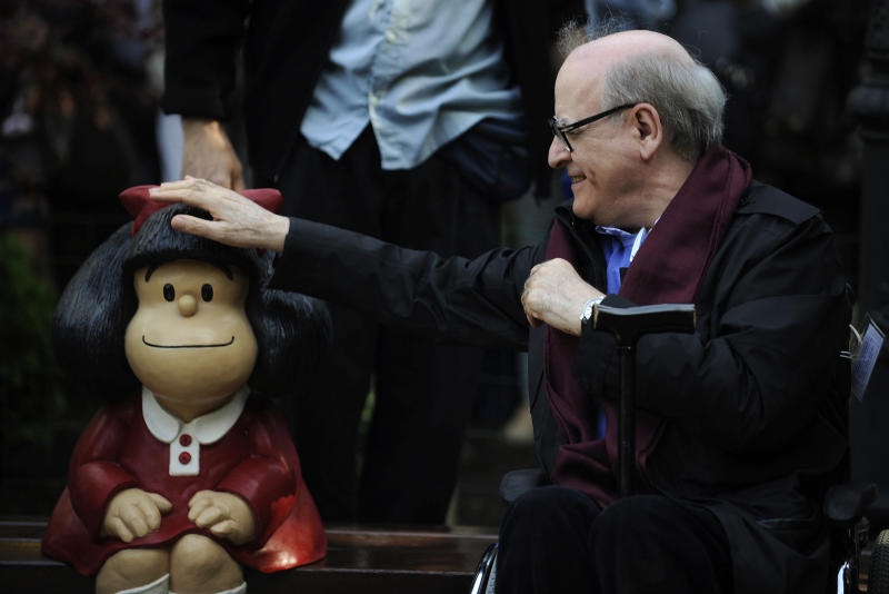 Cartoonist Joaquin Salvador Lavado, also known as Quino, touches a sculpture of his comic character Mafalda, during an opening ceremony of a park of San Francisco in Oviedo, northern Spain, October 23, 2014. Quino will be awarded with the 2014 Prince of Asturias Award for Communication and Humanities at a ceremony on Friday in the Asturian capital. The Prince of Asturias Awards have been held annually since 1981 to reward scientific, technical, cultural, social and humanitarian work done by individuals, teams and institutions. REUTERS/Eloy Alonso (SPAIN - Tags: SOCIETY MEDIA ENTERTAINMENT TPX IMAGES OF THE DAY)