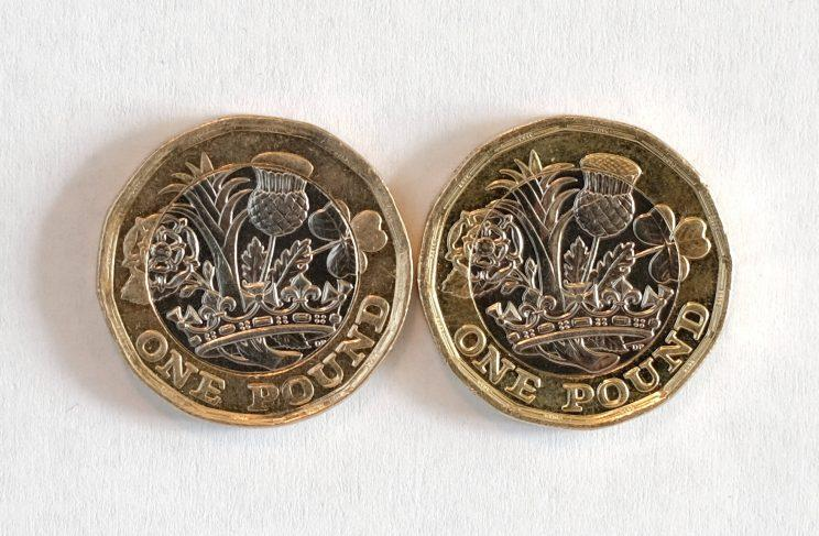 The coin on the left does not have any engraving on the head of the thistle, which Roy Wright says means it is fake (SWNS)