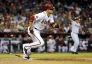 Arizona Diamondbacks' Martin Prado follows through on an RBI base hit against the Baltimore Orioles during the seventh inning of a baseball game, Monday, Aug. 12, 2013, in Phoenix. (AP Photo/Matt York)