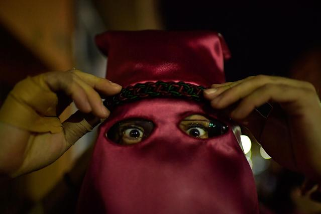 "<p>A penitent prepares to take part in a procession of the ""Santa Veracruz"" brotherhood, during the Holy Week in Calahorra, northern Spain, Wednesday, March 28, 2018. (Photo: Alvaro Barrientos/AP) </p>"