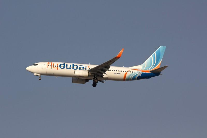 Flydubai Boeing 737-800 airplane is pictured in the sky over Dubai