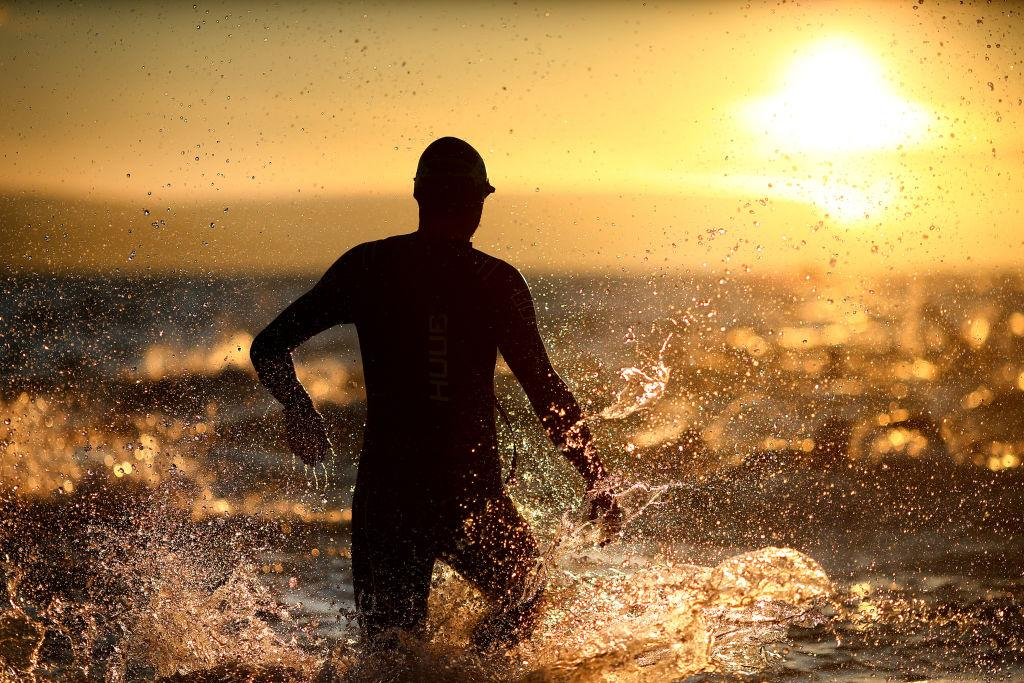 <p>Participants enter the water as they look to start the swim leg of the race during IRONMAN 70.3 Weymouth. (Charlie Crowhurst/Getty Images for IRONMAN) </p>