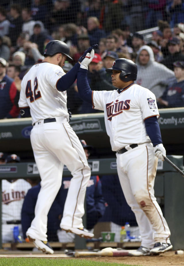 Minnesota Twins' C.J. Cron, left, celebrates his three-run home run off Toronto Blue Jays pitcher Matt Shoemaker with Willians Astudillo in the fourth inning of a baseball game Monday, April 15, 2019, in Minneapolis. (AP Photo/Jim Mone)