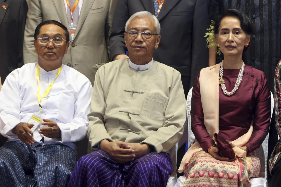 FILE - In this Oct. 15, 2017, file photo, Myanmar's Vice President Myint Swe, left, sits with State Counsellor Aung San Suu Kyi, right, and then President Htin Kyaw, for a photo session after the second anniversary of the signing of nationwide ceasefire agreement at the Myanmar International Convention Center in Naypyitaw, Myanmar. Myanmar military television said Monday, Feb. 1, 2021 that the military was taking control of the country for one year, while reports said many of the country's senior politicians including Suu Kyi had been detained. The military TV report said Commander-in-Chief Senior Gen. Min Aung Hlaing would be in charge of the country, while Myint Swe would be elevated to acting president. (AP Photo/Aung Shine Oo, File)