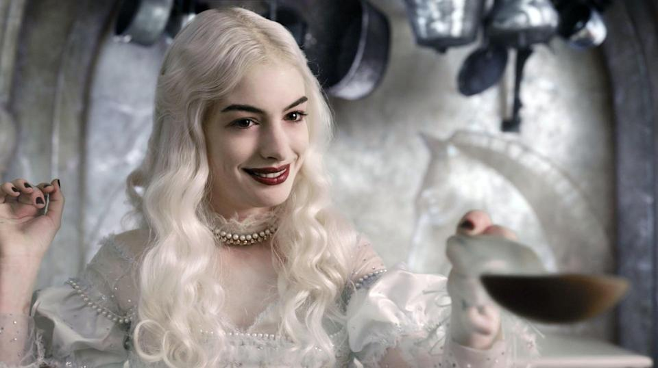 """<p><a class=""""link rapid-noclick-resp"""" href=""""https://www.popsugar.com/Anne-Hathaway"""" rel=""""nofollow noopener"""" target=""""_blank"""" data-ylk=""""slk:Anne Hathaway"""">Anne Hathaway</a>'s graceful yet gothic character, the White Queen, from <strong>Alice in Wonderland</strong> requires silver-white hair, a great, big gown, and a deep, glossy red lip. </p>"""