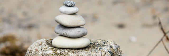 A stack of rocks sits serenely in front of the camera.