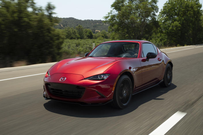 This undated photo provided by Mazda shows the 2019 Mazda MX-5 Miata, a small two-seat roadster. When the engineers designed this Miata generation, they wanted it to weigh the same as the first model that debuted in 1990. (James Halfacre/Mazda North American Operations via AP)