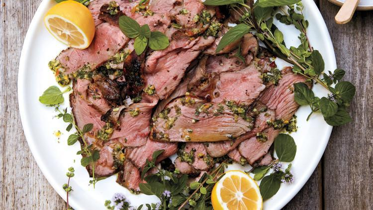 """<p>Boneless leg of lamb makes a spectacular meal. Here, we dress it up with preserved lemon, chopped garlic, dried red chiles, fresh mint, garlic, and marjoram leaves. It's a definite winner. <a href=""""https://www.marthastewart.com/1106693/grilled-leg-lamb-preserved-lemon"""" rel=""""nofollow noopener"""" target=""""_blank"""" data-ylk=""""slk:View recipe"""" class=""""link rapid-noclick-resp""""> View recipe </a></p>"""