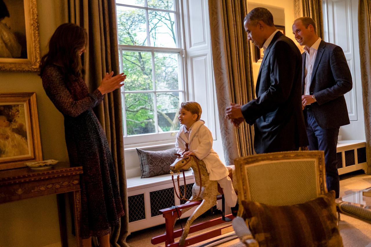 Handout photo issued by Kensington Palace of US President Barack Obama (2nd right) and Britain's Prince William (right) while Catherine, Duchess of Cambridge plays with Prince George as he rides a rocking horse Friday April 22, 2016. Kensington Palace/PA Wire/Handout via ReutersATTENTION EDITORS - THIS IMAGE WAS PROVIDED BY A THIRD PARTY. EDITORIAL USE ONLY. NO RESALES. NO ARCHIVE.      TPX IMAGES OF THE DAY