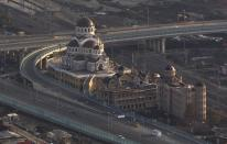 An aerial view from a helicopter shows an Orthodox cathedral under construction in Adler district of the Black Sea resort city of Sochi, December 23, 2013. Sochi will host the 2014 Winter Olympic Games in February. Picture taken December 23, 2013. REUTERS/Maxim Shemetov (RUSSIA - Tags: CITYSPACE SPORT OLYMPICS RELIGION BUSINESS CONSTRUCTION)