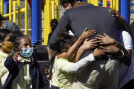 Prince Harry, the Duke of Sussex,gets a group hug from students after he and his wife Meghan, the Duchess of Sussex, visited their school, P.S. 123, the Mahalia Jackson School, in New York's Harlem neighborhood, Friday, Sept. 24, 2021. (AP Photo/Richard Drew)