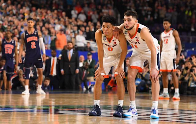 Virginia's Kihei Clark (0) and Ty Jerome (11) watch a free throw late in the semifinal game against Auburn. (Getty)