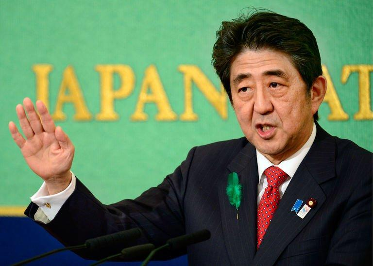 Japanese Prime Minister Shinzo Abe makes a speech at the Japan National Press Club in Tokyo on April 19, 2013