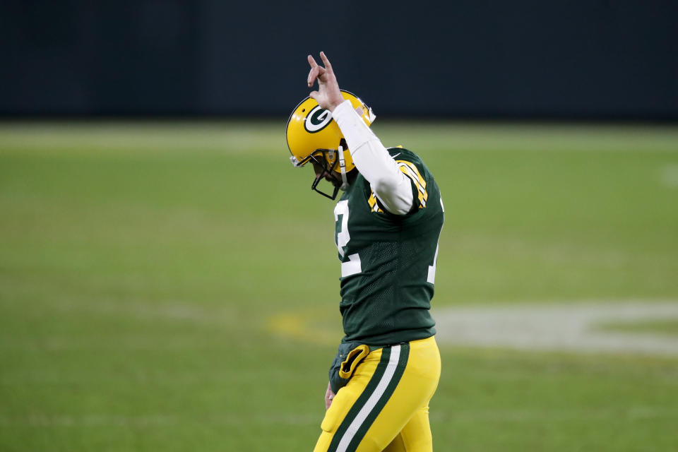 Green Bay Packers quarterback Aaron Rodgers waves after an NFL divisional playoff football game against the Los Angeles Rams Saturday, Jan. 16, 2021, in Green Bay, Wis. The Packers defeated the Rams 32-18 to advance to the NFC championship game. (AP Photo/Matt Ludtke)