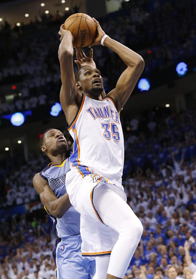 Oklahoma City Thunder forward Kevin Durant (35) goes up for a dunk in front of Memphis Grizzlies guard Tony Allen (9) late in the fourth quarter of Game 2 of an opening-round NBA basketball playoff series in Oklahoma City, Monday, April 21, 2014. Memphis won 111-105 in overtime. (AP Photo/Sue Ogrocki)