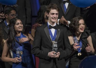 Washington, D.C., March 13, 2018—Benjy Firester (center), 18, of New York City, won first place and $250,000 in Regeneron Science Talent Search 2018, founded and produced by Society for Science & the Public. Isani Singh (left), 18, of Aurora, Colorado, was awarded third place and $150,000, and Natalia Orlovsky (right), 18, of Chadds Ford, Pennsylvania, was awarded second place and $175,000. Photo Credit: Chris Ayers/Society for Science & the Public (PRNewsfoto/Society for Science & the Public)