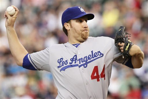 Los Angeles Dodgers starting pitcher Aaron Harang (44) pitches against the Colorado Rockies in the first inning of a baseball game Monday, April 30, 2012 in Denver, Colo.. (AP Photo/Barry Gutierrez)