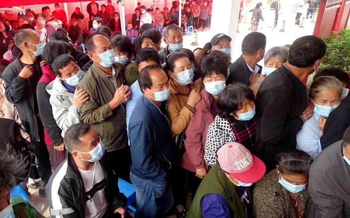 People queue for vaccinations in Anhui Province - Mark Schiefelbein/ChinaTopix