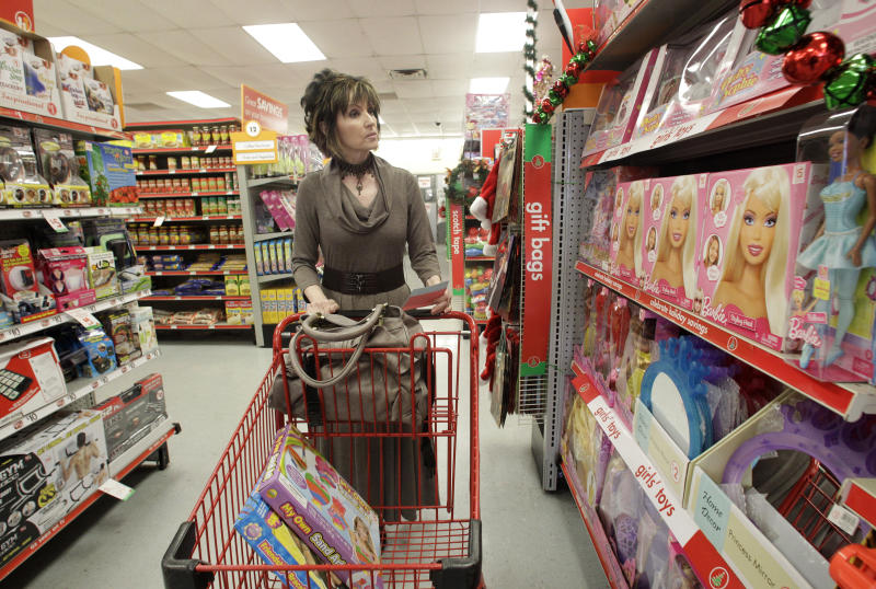 FILE - In this file photo taken Dec. 14, 2010, Polly Brown of Riesel, Texas, shops for holiday gifts at the Family Dollar store, in Waco, Texas. In September 2010, Family Dollar had announced plans to spend $750 million to buy back its stock, which would be partially funded by its cash on hand. Then in October, the retailer said it had repurchased $250 million of its shares as part of its previous announcement.(AP Photo/Tony Gutierrez, file)