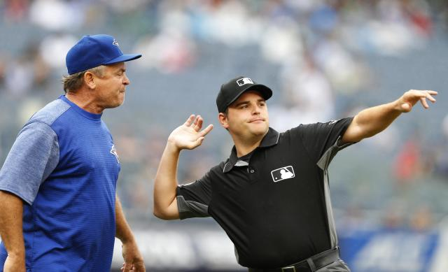 First base umpire Jansen Visconti throws Toronto Blue Jays manager John Gibbons out of the baseball game against the New York Yankees in the sixth inning in New York, Sunday, Aug. 19, 2018. (AP Photo/Noah K. Murray)