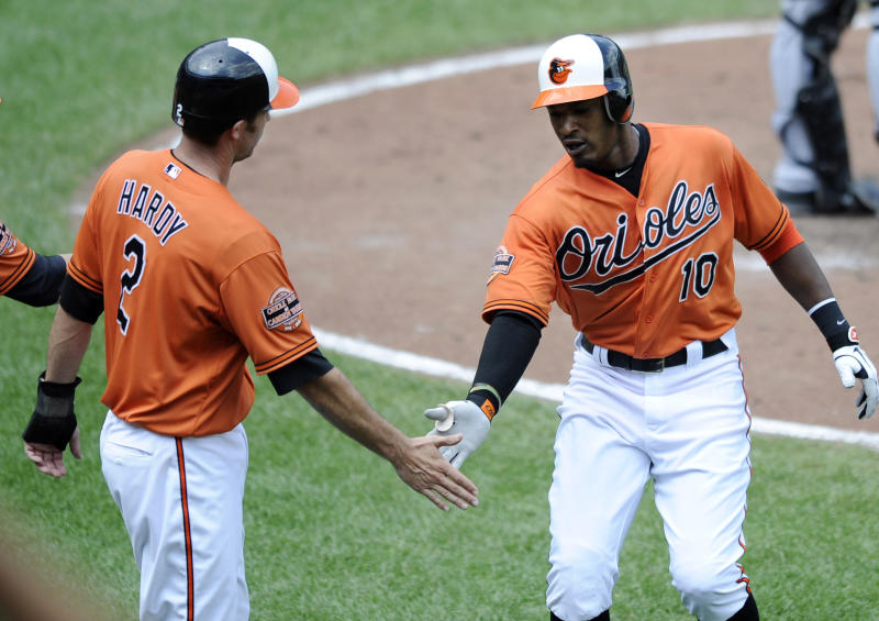 Baltimore Orioles' Adam Jones (10) celebrates his two-run home run with J.J. Hardy (2) during the third inning of a baseball game against the Chicago White Sox, Thursday, Aug. 30, 2012, in Baltimore. (AP Photo/Nick Wass)