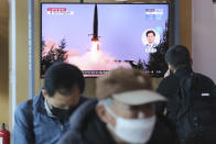 """A TV screen shows a file image of North Korea's missile launch during a news program at the Seoul Railway Station in Seoul, South Korea, Sunday, March 29, 2020. North Korea on Sunday fired two suspected ballistic missiles into the sea, South Korea said, calling it """"very inappropriate"""" at a time when the world is battling the coronavirus pandemic. (AP Photo/Ahn Young-joon)"""