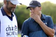 Jodan Spieth, right, talks with his caddie after playing through the 18th green during the third round of the Charles Schwab Challenge golf tournament at the Colonial Country Club in Fort Worth, Texas, Saturday May 29, 2021. (AP Photo/Ron Jenkins)