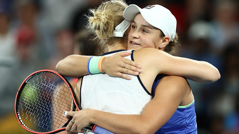 Ash Barty and Jessica Moore, pictured here embracing after their match at the Australian Open.