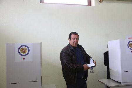 Businessman and opposition leader Gagik Tsarukyan votes during a parliamentary election at a poling station in Yerevan, Armenia, April 2, 2017. Varo Rafayelyan/PAN Photo/Handout via REUTERS