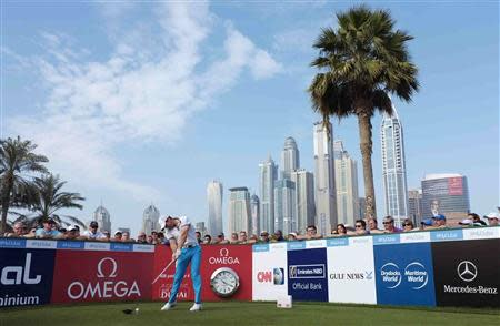 Rory McIlroy of Northern Ireland drives from the tee of the 1st hole during the first round of the 2014 Omega Dubai Desert Classic in Dubai January 30, 2014. REUTERS/Caren Firouz