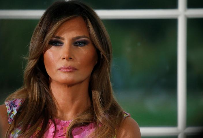 First lady Melania Trump listens as her husband, President Trump, speaks at a dinner with business leaders at Trump National Golf Club in Bedminster, N.J., Aug. 7, 2018. (Photo: Leah Millis/Reuters)