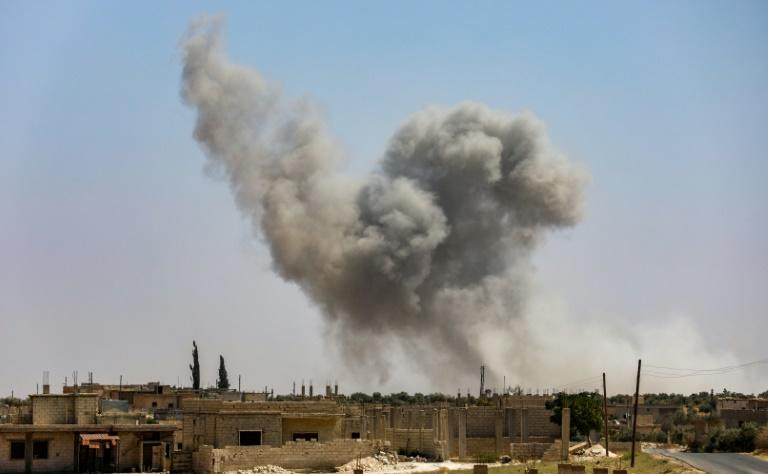 Smoke rises after Syrian government forces strike al-Tamana on the southern edges of Idlib province on September 6, 2018