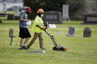 FILE - In this July 17, 2020, file photo, workers use ground penetrating radar as work continues on a search for a potential unmarked mass grave from the 1921 Tulsa Race Massacre, at Oaklawn Cemetery in Tulsa, Okla. A second excavation begins Monday, Oct. 19, 2020, at a cemetery in an effort to find and identify victims of the 1921 Tulsa Race Massacre and shed light on violence that left hundreds dead and decimated an area that was once a cultural and economic mecca for African Americans. (AP Photo/Sue Ogrocki File)