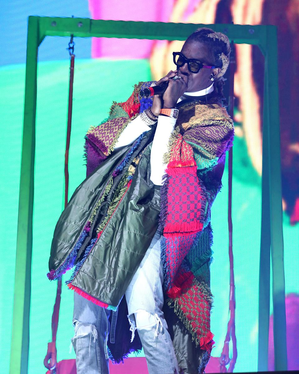 """<h1 class=""""title"""">November 19: Young Thug</h1> <div class=""""caption""""> Young Thug is snug as a bug in this very nice rug. </div> <cite class=""""credit"""">Getty Images</cite>"""