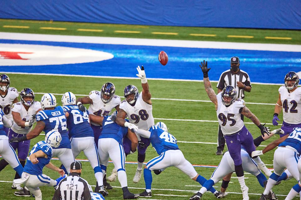 INDIANAPOLIS, IN - NOVEMBER 08: Baltimore Ravens defensive tackle Brandon Williams (98) and Baltimore Ravens defensive end Derek Wolfe (95) battle to block an extra point in action during a NFL game between the Indianapolis Colts and the Baltimore Ravens on November 08, 2020 at Lucas Oil Stadium in Indianapolis, IN. (Photo by Robin Alam/Icon Sportswire via Getty Images)