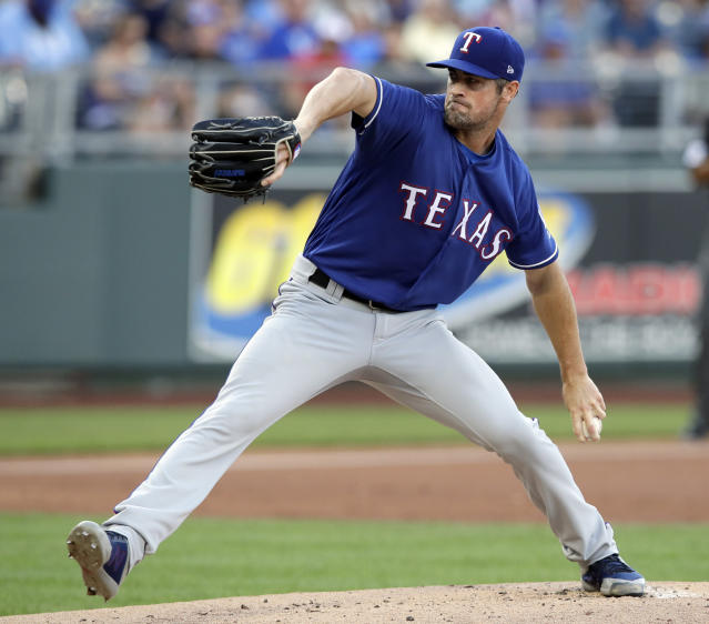 Texas Rangers starting pitcher Cole Hamels delivers to a Kansas City Royals batter during the first inning of a baseball game at Kauffman Stadium in Kansas City, Mo., Tuesday, June 19, 2018. (AP Photo/Orlin Wagner)