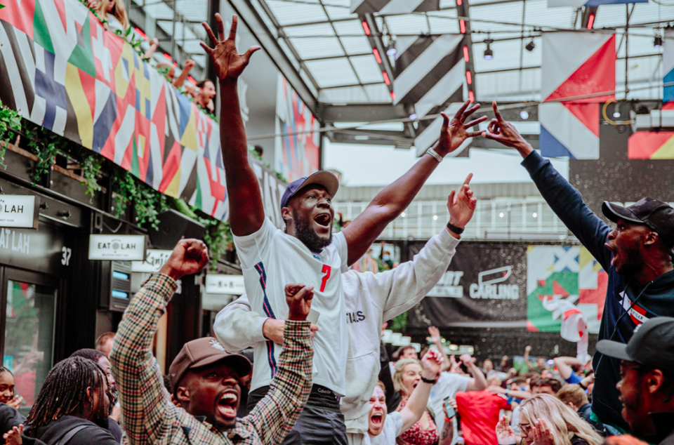 Rapper Stormzy celebrates England's victory over Germany in Euro 2020 round at BOXPARK Croydon in south London. (PA)