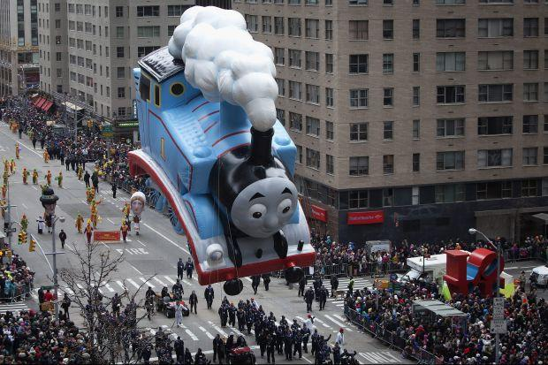 The Thomas The Tank Engine float makes its way down 6th Ave during the Macy's Thanksgiving Day Parade in New York.