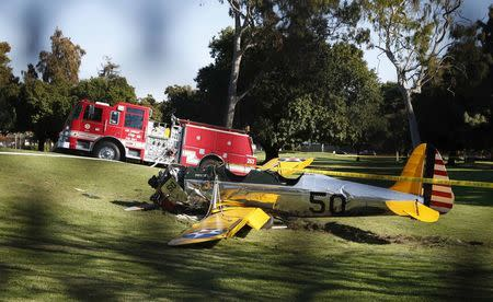 An airplane sits after crash landing at Penmar Golf Course in Venice California March 5, 2015. REUTERS/Lucy Nicholson
