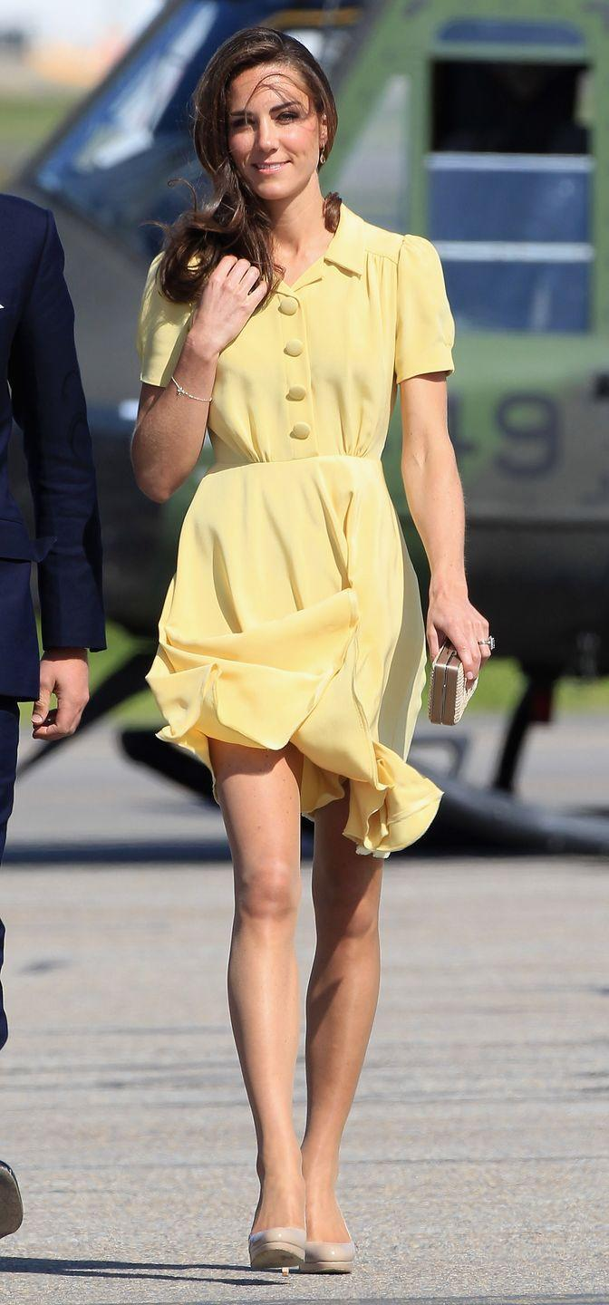 """<p>The newlywed suffered a wardrobe malfunction during a breezy visit to the Calgary Airport. The skirt on her yellow Jenny Packham sundress kept blowing up, and the Queen was <a href=""""https://www.newidea.com.au/kate-middleton-has-marilyn-monroe-moment-when-skirt-blows-up-in-the-wind"""" rel=""""nofollow noopener"""" target=""""_blank"""" data-ylk=""""slk:reportedly displeased"""" class=""""link rapid-noclick-resp"""">reportedly displeased</a> with the incident, urging the Duchess to have <a href=""""https://www.dailymail.co.uk/femail/article-2129545/Just-1-50-secret-weapon-preserves-Her-Modesty--Outfits-curtain-weights-sewn-hem.html"""" rel=""""nofollow noopener"""" target=""""_blank"""" data-ylk=""""slk:curtain weights sewn into the seams of her dresses"""" class=""""link rapid-noclick-resp"""">curtain weights sewn into the seams of her dresses</a> in the future.</p>"""