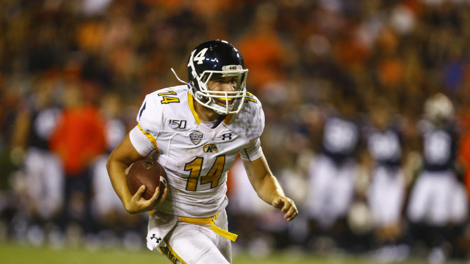 Kent State quarterback Dustin Crum (14) carries the ball during the second half of an NCAA college football game against Kent State, Saturday, Sept. 14, 2019, in Auburn, Ala. (AP Photo/Butch Dill)