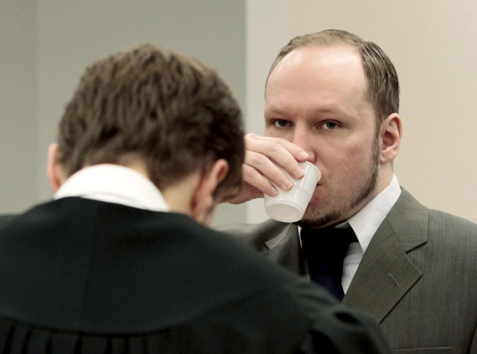 """Mass killer Anders Behring Breivik drinks a glass of water in the courtroom in Oslo, Norway Thursday April 26, 2012. Breivik has slammed a psychiatric report that declared him insane, insisting it was based on """"evil fabrications"""" meant to portray him as irrational and unintelligent. (AP Photo/Hakon Mosvold Larsen/NTB Scanpix, Pool)"""