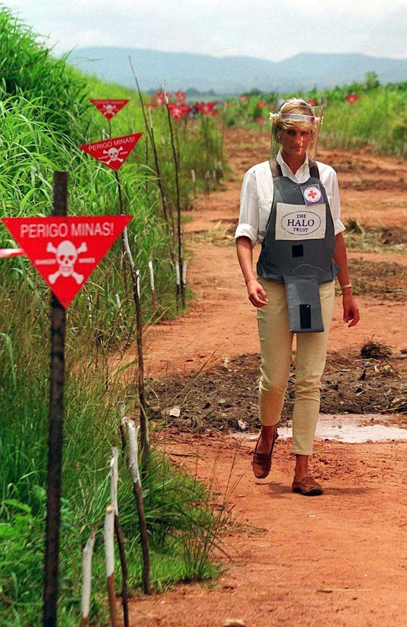 Princess Diana touring a minefield in body armour during her visit to Angola (PA)