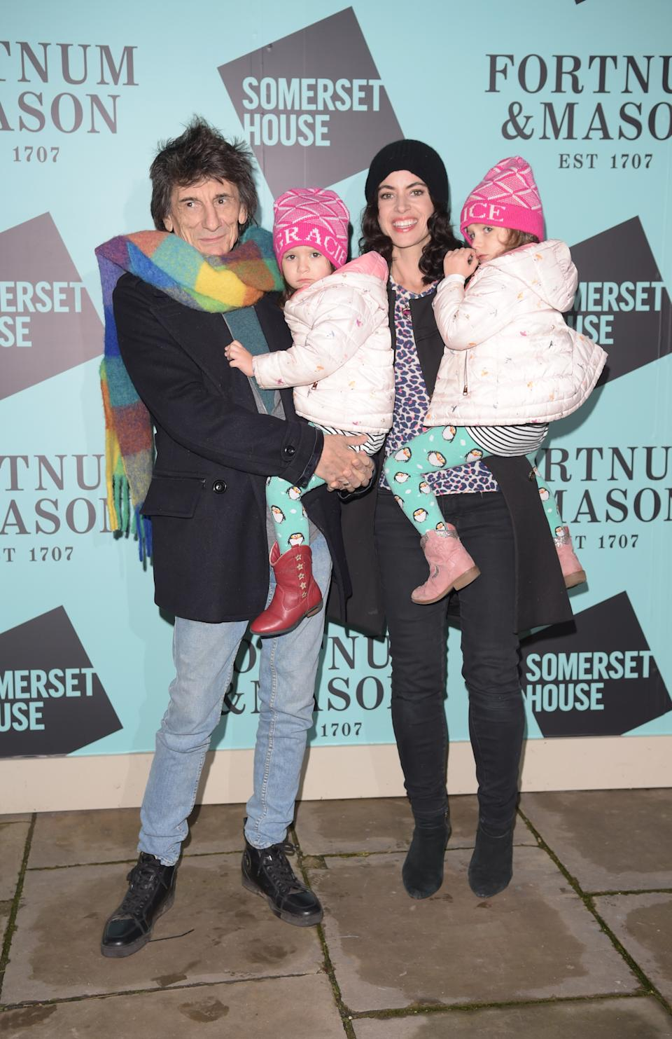 Ronnie Wood and Sally Wood with twins Gracie Jane and Alice Rose attend the opening party of Skate  at Somerset House on November 12, 2019 in London, England. (Photo by David M. Benett/Dave Benett/Getty Images for Fortnum & Mason)