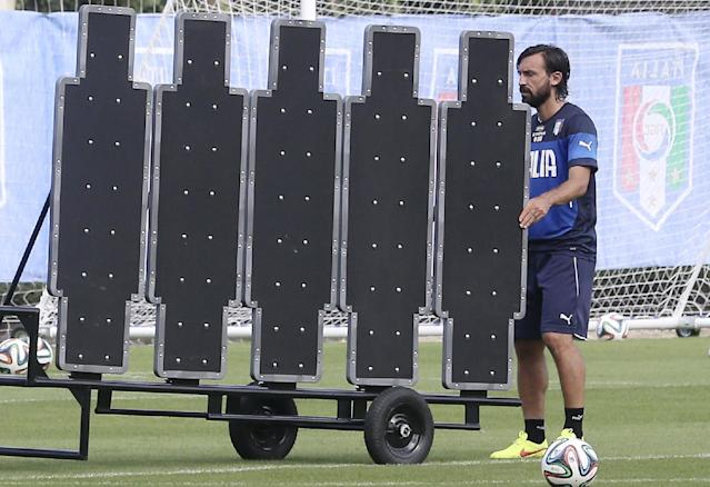 Italy's Andrea Pirlo moves a barrier that he will use to practice his free kicks during a training session in Mangaratiba, Brazil, Wednesday, June 11, 2014. Italy will play in group D at the World Cup. (AP Photo/Antonio Calanni)