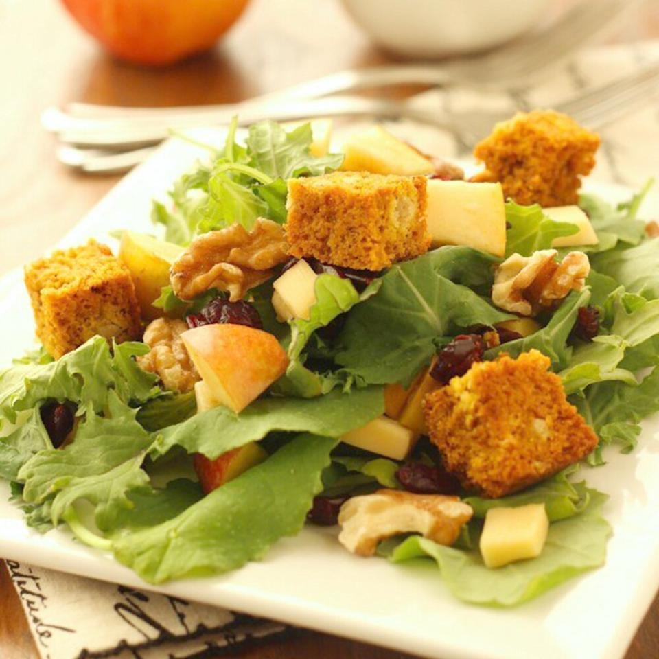 """<p>The best vegan Thanksgiving recipes pack in so much fall flavor, you won't even realize they're completely plant-based. Take this colorful kale salad: In addition to the slightly sweet pumpkin bread croutons, the simple starter showcases seasonal staples such as apples, cranberries, and maple syrup.</p> <p><strong>Get the recipe:</strong> <a href=""""https://cravingsomethinghealthy.com/harvest-salad-with-baby-kale-and-pumpkin-bread-croutons"""" target=""""_blank"""">Harvest Salad with Baby Kale and Pumpkin Bread Croutons </a></p>"""