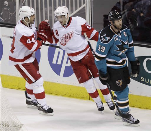 Detroit Red Wings center Pavel Datsyuk, center, is congratulated by right wing Todd Bertuzzi (44) after scoring past San Jose Sharks center Joe Thornton (19) in the first period of an NHL hockey game in San Jose, Calif., Saturday, March 17, 2012. (AP Photo/Paul Sakuma)